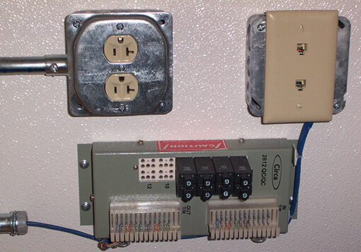 an electrical circuit with two power outlet and one power supply, it is inside a storage container.