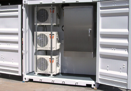 3 HVAC system with an electrical vault, its inside a white storage container.