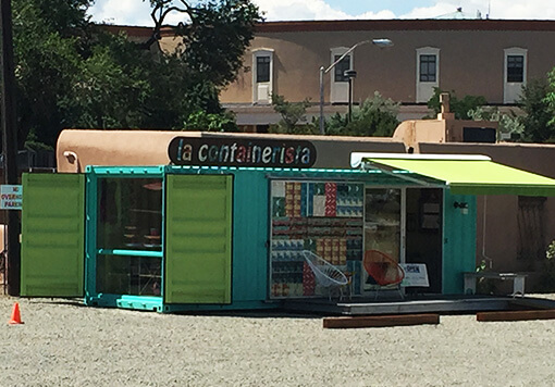 Green and rectangular mobile storage shaped as a convenient store having a name of