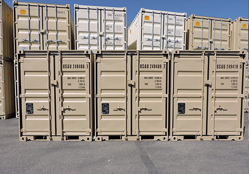 Flesh and white colored mobile storage piled-up together and is placed on a gray concrete floor, with the blue sky as a background and that is used as a storage containers Albuquerque of Maloy Mobile Storage.